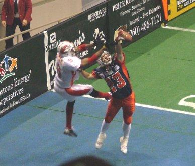 Scott Heighland breaking up a sure TD pass