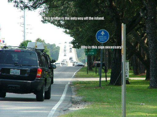 This is the only bridge off Oak Island.  So why do they need this 'Hurricane Evacuation Route' sign?