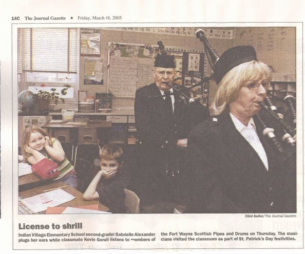 License to shrill - Indian Village Elementary School second-grader Gabrielle Alexander plugs her ears while classmate Kevin Gorall listens to members of the Fort Wayne Scottish Pipes and Drums on Thursday.  The musicians visited the classroom as part of St. Patrick's Day festivities.