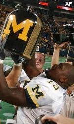 Larry Stevens hoists the Little Brown Jug